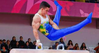 Brazilian Caio Souza competes in the men's artistic gymnastics event at Lima 2019, in the Villa El Salvador Sports Center.