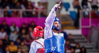 Andres Molina from Costa Rica celebrates his victory against Brazil in Lima 2019 men's Para taekwondo K44 -75 kg at the Callao Regional Sports Village.