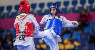 Juan Samorano from Argentina and Shiroy Renteria from Peru compete for the bronze in Lima 2019 men's Para taekwondo K44 +75 kg at the Callao Regional Sports Village.