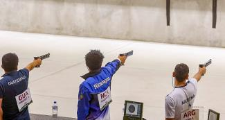 Albino Jimenez from Guatemala, Rafael Lacayo from Nicaragua and Sebastian Lobo from Argentina during the men's 10 air pistol m competition at Las Palmas Air Base.
