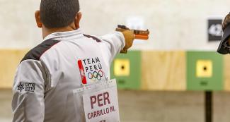 The Peruvian Marko Carrillo competing in men's 10 m air pistol at Las Palmas Air Base.