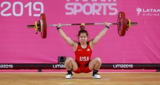Jourdan Delacruz from the USA competes in the women's 55 kg weightlifting event, held at the Chorrillos Military School at the Lima 2019 Games.