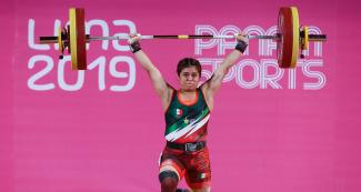 Ana Lopez from Mexico showing her skills at the women's 55 kg weightlifting competition, held at the Chorrillos Military School at Lima 2019.