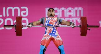 Honduran Jorge Hernandez competes in the men's 73 kg weightlifting event at the Chorrillos Military School at Lima 2019.