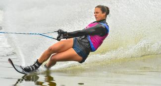 Regina Jaquess from the US slides on the water during the Lima 2019 water ski competition at Laguna Bujama.